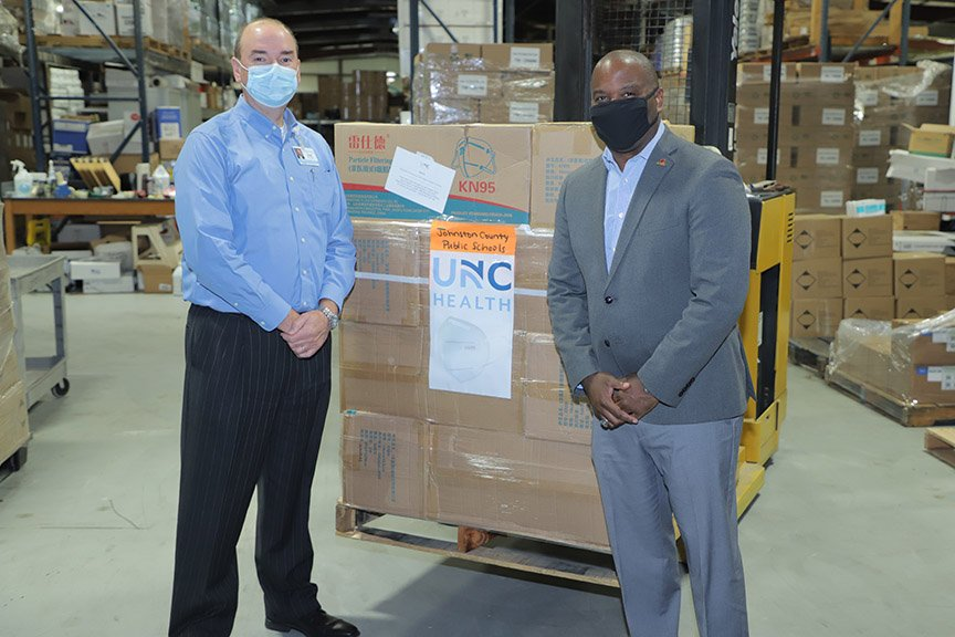Tom Williams, Johnston Health CEO and Dr. Eric Bracy, Johnston County Public Schools Superintendent stand with mask donation