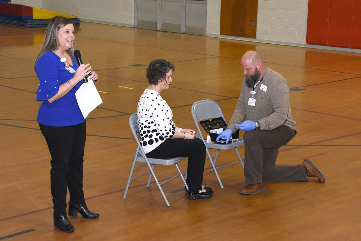 Four Oaks Elementary School Principal Kathy Parrish gets her blood checked