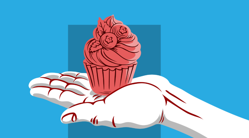 Hand holding out a cupcake.